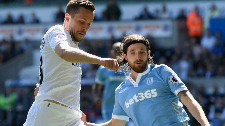 Premier League football Swansea v Stoke - Gylfi Sigurdsson and Joe Allen
