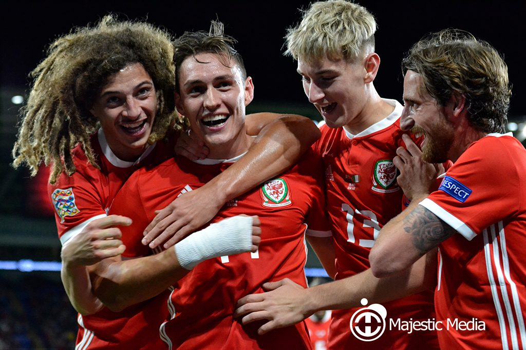 Connor Roberts celebrates scoring for Wales