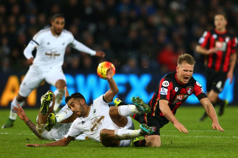 Neil Taylor in action against AFC Bournemouth